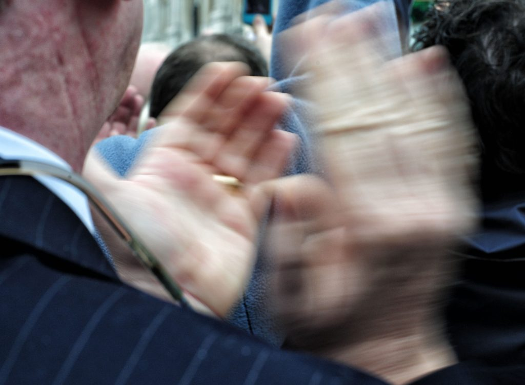 Elderly man clapping